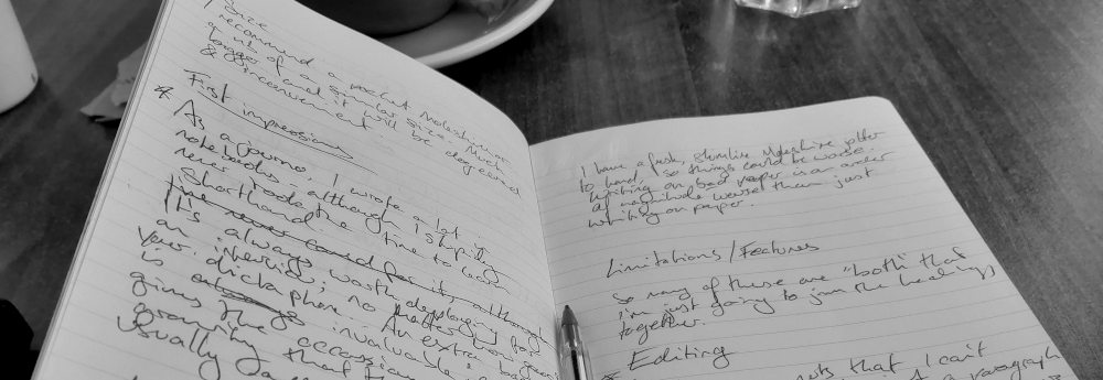 Notebook open on double page of handwriting