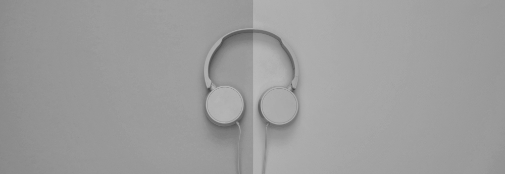 Headphones on split background