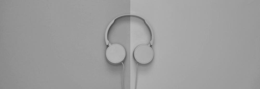 Headphones on split background